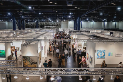 Areal perspective of Art Market San Francisco with visitors looking around the exhibition spaces