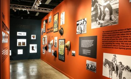 John Wayne Room 2 with images, text and memorabilia hung on walls