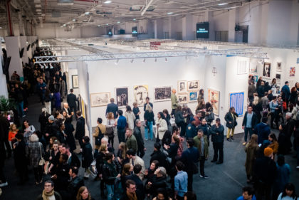 Crowded art fair on opening night, view from above