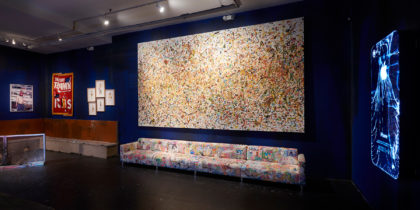 Installation view of a painting and a painted couch